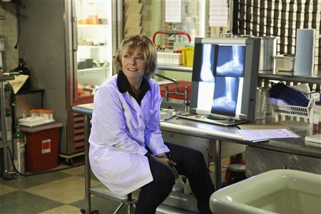 Actress Jane Curtin portrays Medical Examiner Joanne Webster in a scene from the CBS television series ''Unforgettable'' in this undated publicity photograph. REUTERS/Giovanni Rufino/CBS © 2012 CBS. All Rights