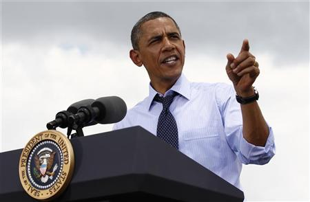 U.S. President Barack Obama speaks after touring the Port of Tampa in Florida, April 13, 2012. REUTERS/Kevin Lamarque