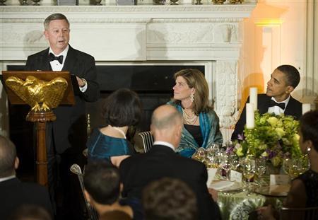 U.S. President Barack Obama (R) listens to remarks by Nebraska Governor Dave Heineman (L) to speak before a National Governors Association dinner at the White House in Washington, February 26, 2012. REUTERS/Jonathan Ernst