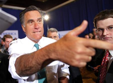 U.S. Republican presidential candidate and former Massachusetts Governor Mitt Romney greets audience members during a campaign stop in Warwick, Rhode Island April 11, 2012. REUTERS/Brian Snyder