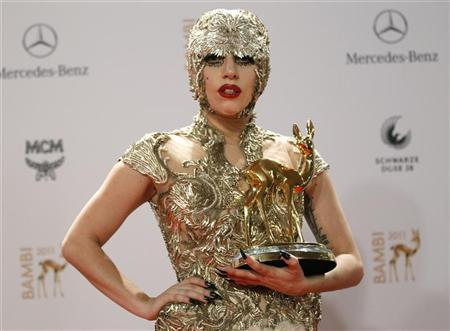 Lady Gaga poses with the trophy for Pop International during the 63rd Bambi media awards ceremony in Wiesbaden, November 10, 2011. REUTERS/Alex Domanski