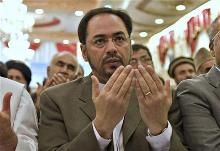 Salahuddin Rabbani (C) prays after he was introduced as the care taker to Jamiat-e Islami party during a gathering at the Kabul Intercontinental Hotel in this October 4, 2011 file photo. REUTERS/Ahmad Masood/Files
