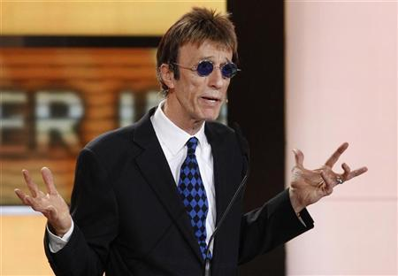 British musician Robin Gibb prepares to present U.S.actor John Travolta the award for best international actor during the 46th 'Goldene Kamera' (Golden Camera) awards ceremony at the Ullstein Auditorium in Berlin, February 5, 2011. The Golden Cameras are awarded by a popular German TV-magazine honouring excellence in the areas of television, film and entertainment. REUTERS/Tobias Schwarz