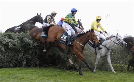 Neptune Collonges (R) ridden by Daryl Jacob jump the Chair during the Grand National Steeple Chase at Aintree, northern England April 14, 2012. REUTERS/Russell Cheyne