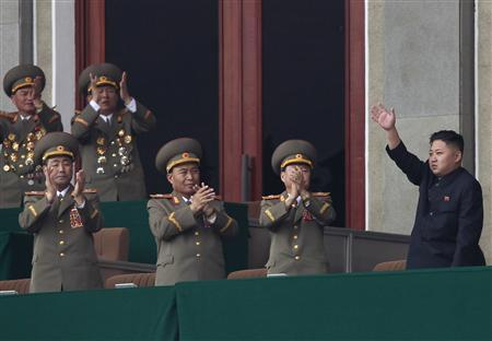 North Korea leader Kim Jong-un (R) is applauded by military officers as he waves to soldiers and civilians during a ceremony in Pyongyang April 14, 2012, one day before the centenary of the birth of North Korea founder Kim Il-sung on Sunday. REUTERS/Bobby Yip