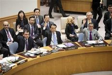 China's Ambassador to the United Nations Li Baodong votes during a Security Council meeting at the United Nations in New York April 14, 2012. The U.N. Security Council on Saturday unanimously authorized the deployment of up to 30 unarmed observers to Syria to monitor the country's fragile ceasefire. Russia and China joined the other 13 council members and voted in favor of the Western-Arab draft resolution. REUTERS/Allison Joyce