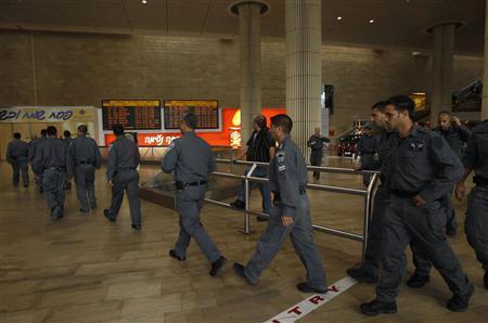 Israeli policemen walk in the arrivals hall at Ben Gurion International Airport near Tel Aviv April 15, 2012. REUTERS/Ronen Zvulun