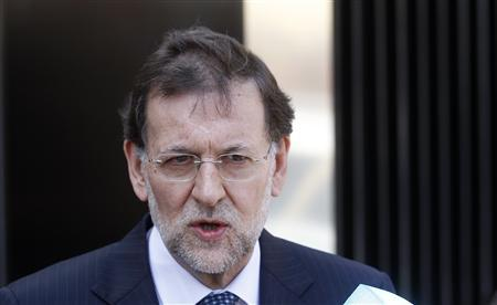 Spain's Prime Minister Mariano Rajoy talks to reporters after visiting Spain's King Juan Carlos at a hospital in Madrid April 15, 2012. King Juan Carlos underwent hip replacement surgery in Madrid on Saturday after breaking his right hip in a fall during a private trip to Botswana, the Royal Household said. REUTERS/Andrea Comas