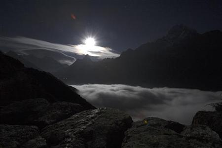 A view of Mount Everest is seen during moon rise from Syangboche in Nepal December 3, 2009. REUTERS/Gopal Chitrakar/Files