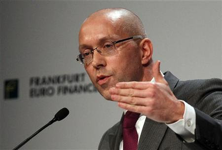 Germany's Finance State Secretary Joerg Asmussen holds his speech during the 14th Euro Finance Week in Frankfurt November 14, 2011. REUTERS/Alex Domanski