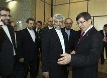 Turkey's Foreign Minister Ahmet Davutoglu (R) welcomes Iran's chief negotiator Saeed Jalili (2nd R) before their meeting in Istanbul April 14, 2012. REUTERS/Hakan Goktepe/Pool