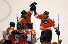 Philadelphia Flyers' Jakub Voracek (R) celebrates with teammates Scott Hartnell, top left, Wayne Simmonds (17) Braydon Coburn (5) and Sean Couturier after Simmonds scored on the Pittsburgh Penguins during the second period in Game 3 of their NHL Eastern Conference quarterfinal playoff hockey series in Philadelphia, April 15, 2012. REUTERS/Tim Shaffer