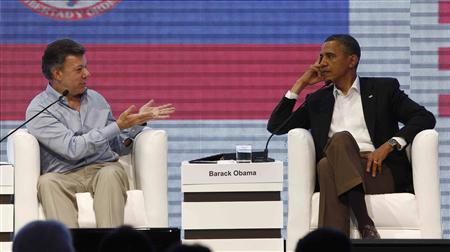 U.S. President Barack Obama and Colombian President Juan Manuel Santos (L) participate in the CEO Summit of the Americas in Cartagena April 14, 2012. REUTERS/Kevin Lamarque
