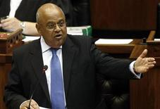 South Africa's Minister of Finance Pravin Gordhan delivers the 2010 budget speech at parliament in Cape Town, February 17, 2010.  REUTERS/Nic Bothma/Pool