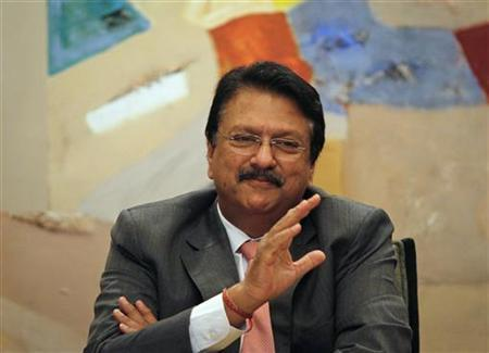 Chairman of Piramal Healthcare Ltd. Ajay Piramal gestures as he speaks during a news conference in Mumbai February 6, 2012. REUTERS/Danish Siddiqui/Files