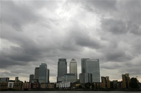 Storm clouds are seen above the Canary Wharf financial district in London on August 3, 2010.  REUTERS/Greg Bos
