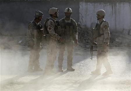 Security forces are seen at the site of an incident in Kabul April 16, 2012. REUTERS/Omar Sobhani