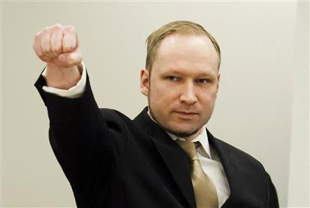 Norwegian mass killer Anders Behring Breivik gestures as he arrives for his terrorism and murder trial in a courtroom in Oslo April 16, 2012. REUTERS/Heiko Junge/Pool