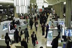Shoppers browse at Macy's Manhattan department store in New York, January 12, 2012. REUTERS/Eduardo Munoz