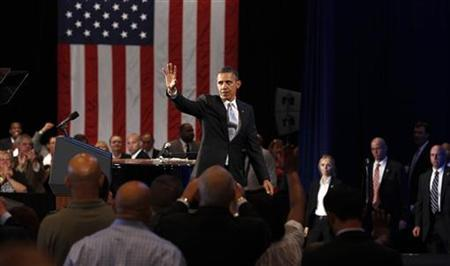 U.S. President Barack Obama waves to supporters at a campaign fund raising event in Hollywood, Florida, April 10, 2012. REUTERS/Kevin Lamarque