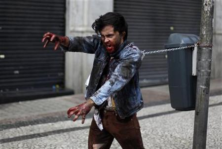 A man, made up to look like a zombie, takes part in a zombie parade in Sao Paulo November 2, 2011. REUTERS/Nacho Doce