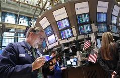 Traders work on the floor of the New York Stock Exchange, April 13, 2012. REUTERS/Brendan McDermid