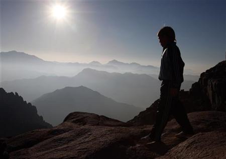 A boy walks on Mount Moses in the Sinai Peninsula August 10, 2009. REUTERS/Goran Tomasevic