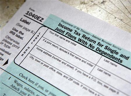 A tax form is pictured on tax deadline day at the main Post Office in New York April 15, 2009. REUTERS/Chip East