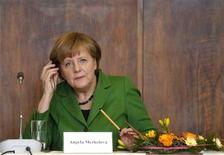 German Chancellor Angela Merkel attends a meeting with students at the Faculty of Law of the Charles University in Prague April 3, 2012. REUTERS/Petr Josek