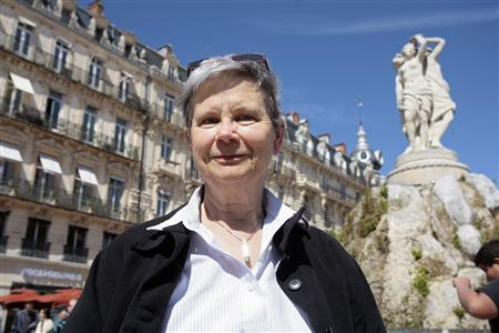 Genette Eysselinck, who renounced her U.S. citizenship to become Belgian, poses in Place de la Comedie in Montpellier April 11, 2012. REUTERS/Pascal Parrot