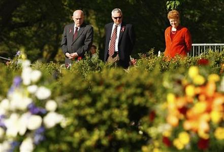 Mark McNamee (L), Senior Vice President and Provost, Jack Finney (C), Associate Provost for Faculty Affairs and Ellen Plummer (R), Assistant Provost walk through the April 16 memorial reading of the names of the 32 people killed on the campus of Virginia Tech in Blacksburg, Virginia April 16, 2012. REUTERS/Chris Keane