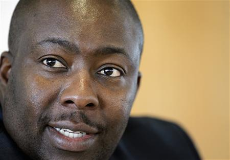 Zimbabwe's Minister of Youth Development, Indigenisation and Empowerment Saviour Kasukuwere speaks during the Reuters Africa Investment Summit in Sandton April 16, 2012. Zimbabwe's empowerment minister expects to finalise the transfer of majority stakes in foreign mining companies to local black investors by the end of April. Kasukuwere, a rising star in President Robert Mugabe's ZANU-PF Party, has been the enforcer-in-chief of a controversial law that requires foreign companies to hand over 51 percent of their holdings in the country to black investors. REUTERS/Siphiwe Sibeko