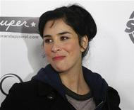 "Actress and comedienne Sarah Silverman smiles as she arrives as a guest for the premiere of the new film ""Super"" in Hollywood, California March 21, 2011. REUTERS/Fred Prouser"