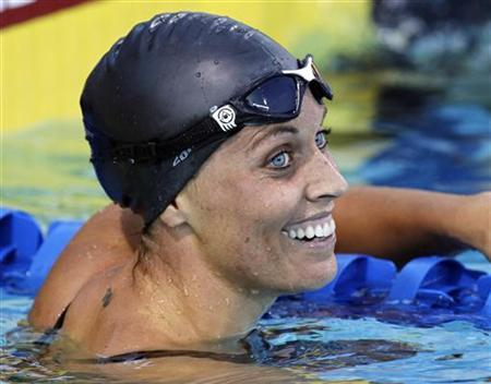Amanda Beard reacts after swimming to a second place finish in the women's 200m breaststroke final at the U.S. National Swimming Championships in Irvine, California August 7, 2010. REUTERS/Danny Moloshok