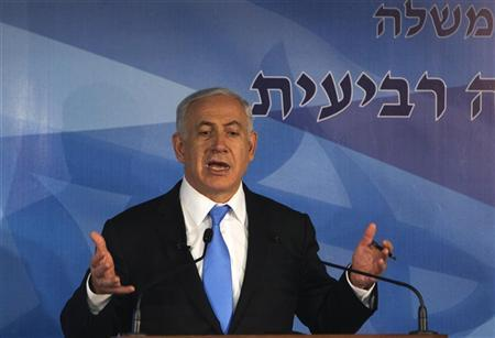 Israeli Prime Minister Benjamin Netanyahu gestures as he speaks during a news conference marking the third anniversary of his right-wing government in power, at the new premises of Government Press Office in Jerusalem April 3, 2012. REUTERS/Ronen Zvulun