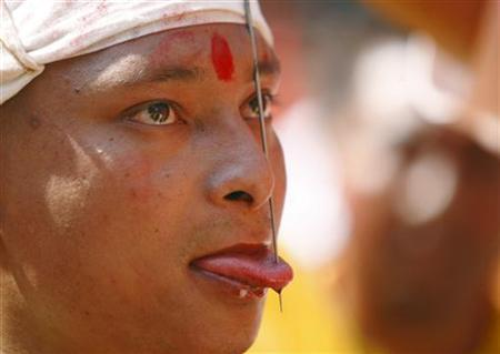 Jujubhai Bans Shrestha is pictured after getting his tongue pierced with an iron spike during the Tongue Penetration Festival at Bode near Kathmandu April 14, 2012. REUTERS/Navesh Chitrakar