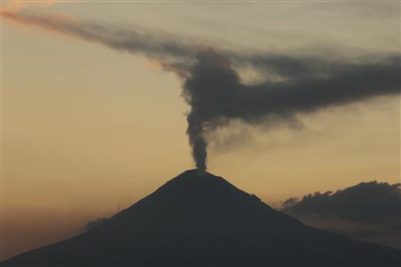 The Popocatepetl volcano spews a cloud of ash and steam high into the air as seen from Puebla, 100 km (62 miles) east of Mexico City April 14, 2012. REUTERS/Imelda Medina