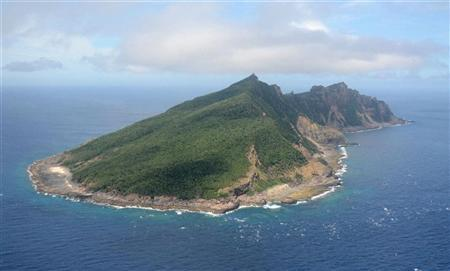 Uotsuri island, part of the disputed islands in the East China Sea, known as the Senkaku isles in Japan, Diaoyu islands in China, is seen in the East China Sea, in this photo taken by Kyodo on June 19, 2011. REUTERS/Kyodo