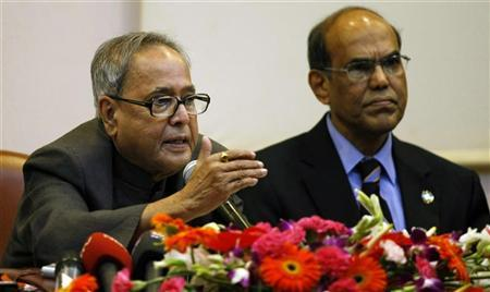 Finance Minister Pranab Mukherjee (L) speaks as Reserve Bank of India's (RBI) Governor Duvvuri Subbarao watches during a news conference at the RBI head office in Mumbai March 6, 2010. REUTERS/Punit Paranjpe/Files