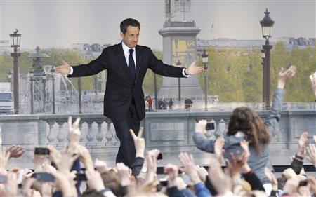 France's President and UMP party candidate for the 2012 French presidential elections Nicolas Sarkozy, leaves the podium as he ends his speech at a political rally on the place de la Concorde in Paris, April 15, 2012. REUTERS/Gonzalo Fuentes