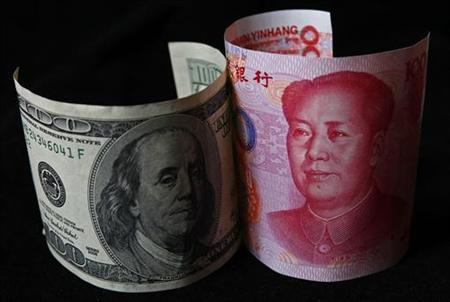 A 100 yuan banknote (R) is placed next to a $100 banknote in this picture illustration taken in Beijing November 7, 2010. REUTERS/Petar Kujundzic/Files