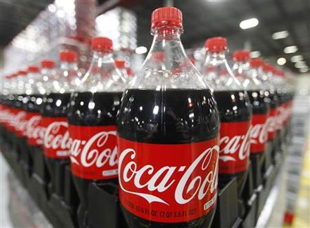 Bottles of Coca-Cola are seen in a warehouse at the Swire Coca-Cola facility in Draper, Utah March 9, 2011. REUTERS/George Frey