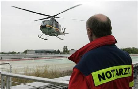 Berlin's emergency doctor Joerg Benecker watches as intensive care transport helicopter ITH ''Christoph Berlin'' lands on the roof of the Unfallkrankenhaus Berlin (UKB) hospital May 7, 2007. REUTERS/Fabrizio Bensch