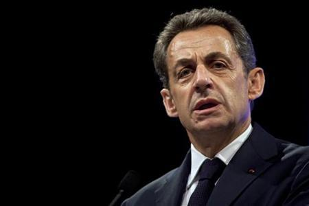 France's President and UMP party candidate for re-election in the 2012 French election, Nicolas Sarkozy, gestures as he delivers a speech before building trade professionals as part of his campaign in Paris, April 17, 2012. REUTERS/Thibault Camus/Pool