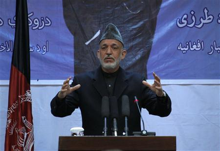 Afghan President Hamid Karzai speaks during a gathering in Kabul April 17, 2012. REUTERS/Omar Sobhani