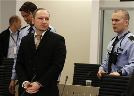 Norwegian mass killer Anders Behring Breivik (C) looks on before being escorted for a 30-minute recess shortly after the start of the second day of his terrorism and murder trial in Oslo April 17, 2012. Breivik, 33, has admitted setting off a car bomb that killed eight people at government headquarters in Oslo last July, then killing 69 in a shooting spree at a summer youth camp organised by the ruling Labour Party. The trial is scheduled to last 10 weeks, during which the court must rule on both his guilt, and his sanity. REUTERS/Stoyan Nenov