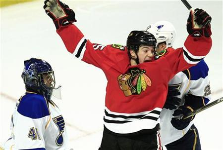 Chicago Blackhawks' Andrew Shaw (C) celebrates a goal scored by teammate Brent Seabrook against St. Louis Blues' goalie Jaroslav Halak (L) and Alex Pietrangelo during the third period of their NHL hockey game in Chicago, March 13, 2012. REUTERS/Jim Young