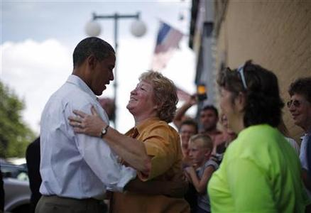 U.S. President Barack Obama meets a local woman following his lunch with five post-9/11 Minnesota veterans at Old Market Deli in Cannon Falls, Minnesota August 15, 2011. REUTERS/Jason Reed