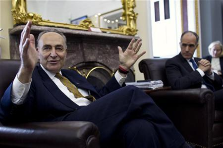 Senators Charles Schumer (D-NY) (L) and Bob Casey (D-PA) talk to the media at the Capitol in Washington December 17, 2011. REUTERS/Benjamin Myers