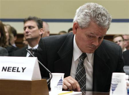 Jeff Neely of the General Services Administration (GSA) leaves after he declined to testify before the House Oversight and Government Reform Committee hearing on ''Addressing GSA's Culture of Wasteful Spending'' on Capitol Hill in Washington April 16, 2012. REUTERS/Yuri Gripas